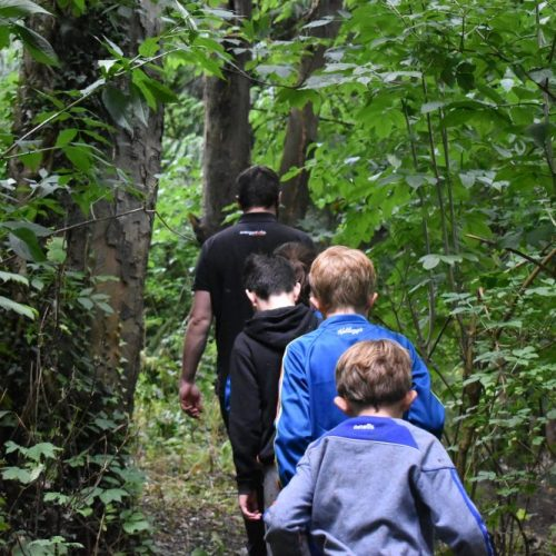 Children going on a nature walk with their Bushcraft Instructor at Xtreme.ie's Midterm Camp at Carton House.