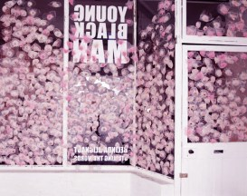 Images from Belinda Blignaut's installation at Young Blackman Gallery, Cape Town, wherein she chewed hundreds or thousands of pieces of pink bubble gum and then placed them on the walls, glass and doors of the gallery. Installation view images and also images of Belinda Blignaut blowing bubbles and pressing them against walls and glass.