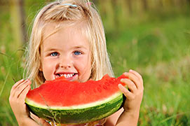 Young girl eating watermelon.  Recipes and Cookbooks, send us your ideas.