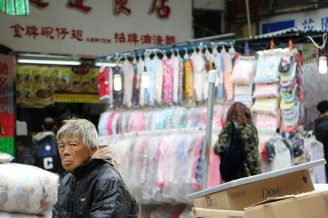 How does it feel to be eking by in a cutthroat city of tremendous affluence? Captured at Ladie's Market, MongKok