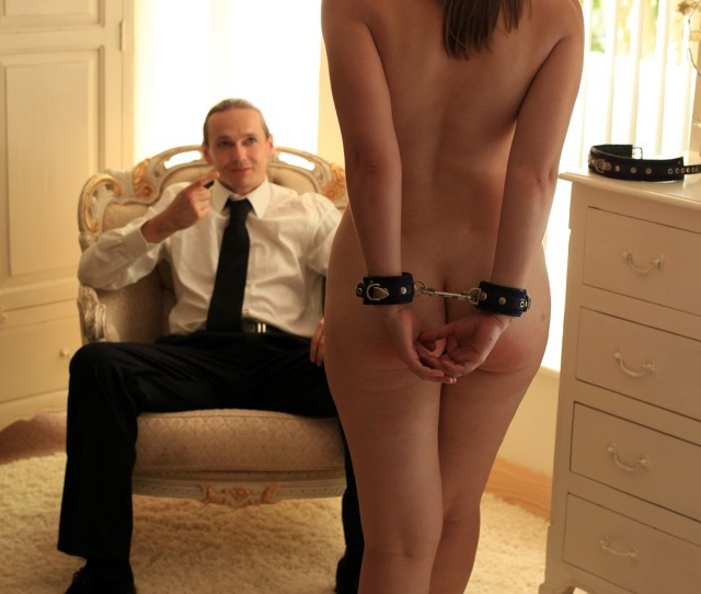 A Naked Cuffed Submissive Walks Towards Her Master As He Beckons Her To Come Clo