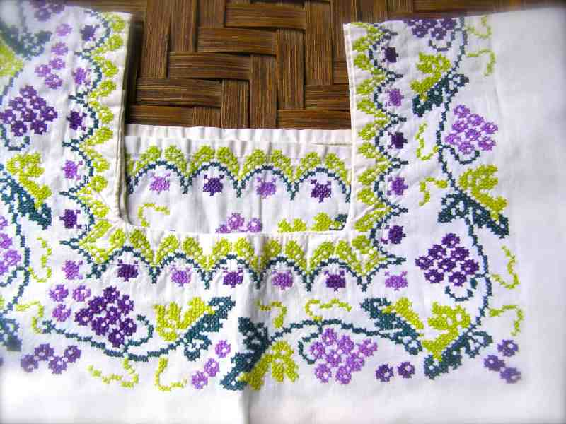 traditional cross stitch used on a Mexican embroidered dressd