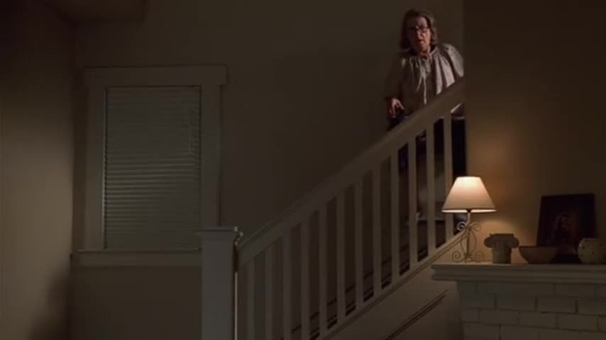Livia Soprano is going down the stairs in her motorized wheelchair.