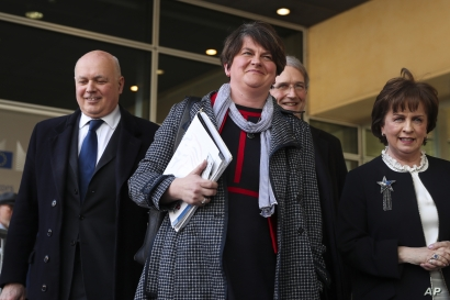 FILE - In this Thursday, April 11, 2019 file photo, Northern Ireland Democratic Unionist Party leader Arlene Foster, center,…