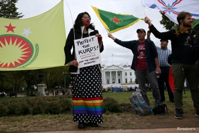 Dr. Sophia Marjanovic participates with others at a rally to protest U.S. President Donald Trump's decision to withdraw U.S…