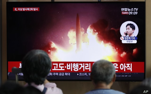 People watch a TV news program reporting about North Korea's firing projectiles with a file image at the Seoul Railway Station in Seoul, South Korea, Aug. 16, 2019.