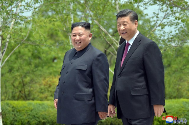 Chinese President Xi Jinping and North Korean leader Kim Jong Un walk during Xi's visit in Pyongyang, North Korea in this picture released by North Korea's Korean Central News Agency (KCNA) on June 21, 2019.