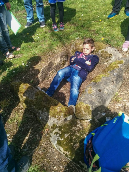 Lee trying out cist in Balbirnie Stone Circle