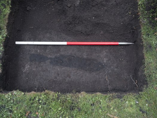 Patch of burnt material in the trench