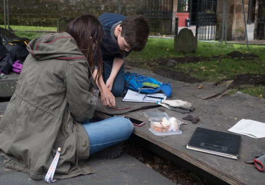 Alexander and Charlotte studying some of the human bone recovered