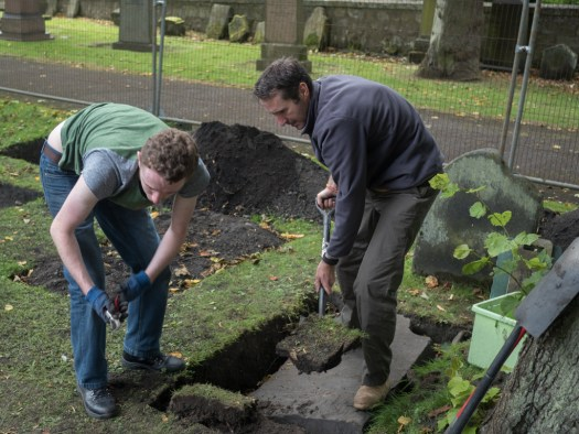 Dougie and Kieron enlarging a trench to improve access to another gravestone