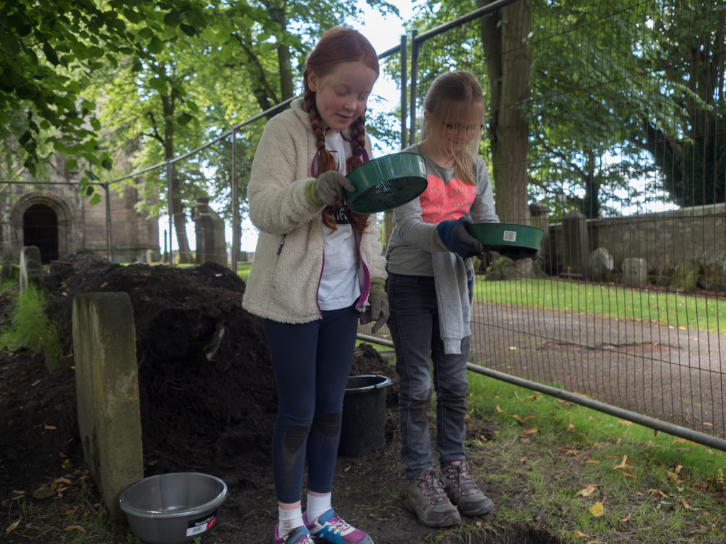 A pair of sievers sieving