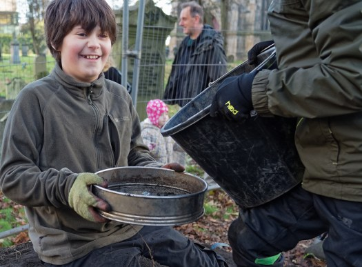 Happiness is a sieve and a bucket-full of graveyard dirt!