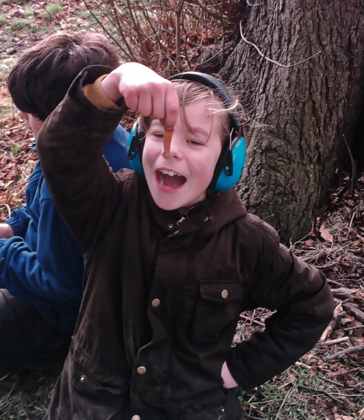Triumphant young archaeologist
