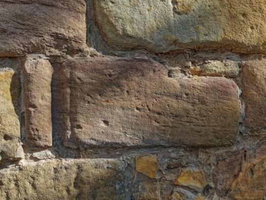 Architectural fragment reused as part of the presinct wall