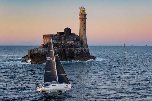 Rob Craigie and Deb Fish win the IRC Two Handed Class and the Boyd Trophy for Mixed Two Handed Division in their Sun Fast 3600 Bellino, seen here rounding the Fastnet Rock © Rolex / Carlo Borlenghi http://www.carloborlenghi.net