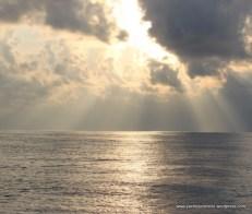 Shafts of sunlight between clouds