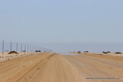 """On the first day of the journey"" .... desert road complete with mirage"