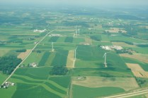 Agriculture and wind energy share the landscape near Springfield Corners.