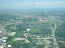 Looking east down I-94 towards Milwaukee beyond the urban fringe of Madison.