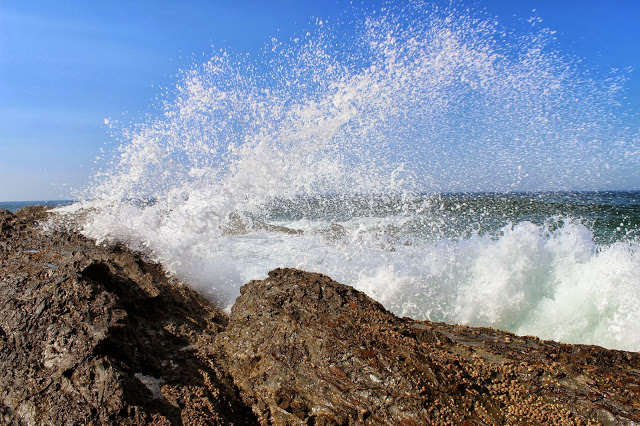Waves jumping up rocks along the shoreline at Coolangatta