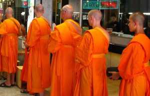 Buddhist monks line up during a shop blessing
