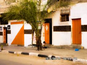 All the doors in our neighborhood are colored with white and orange, it gives our neighborhood a special nice simple look.