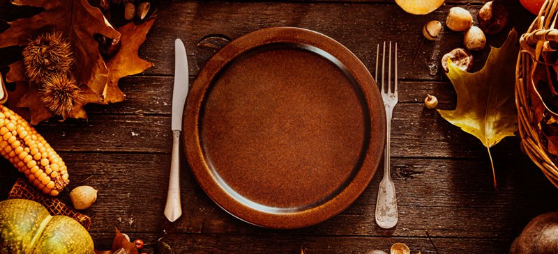 Festive dinner table with empty plate