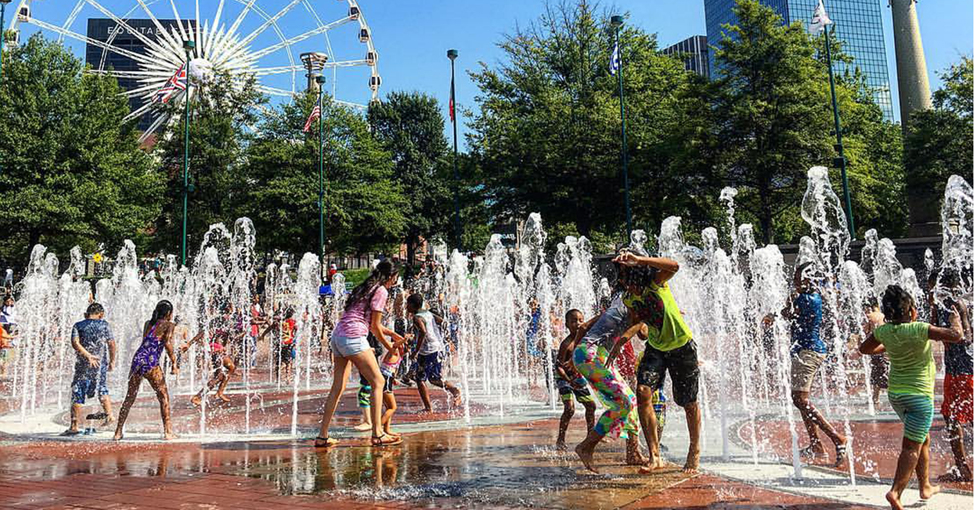 Children cooling off in fountain