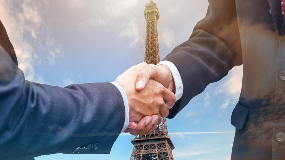Eiffel Tower and handshake