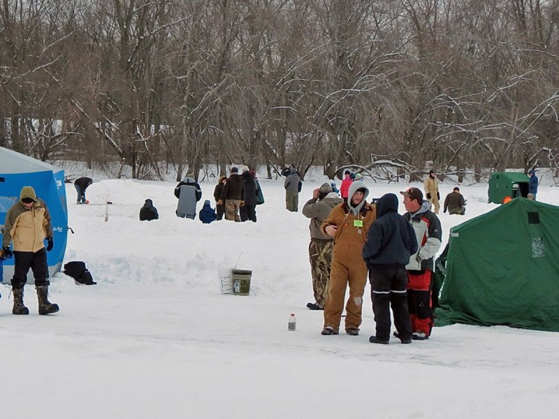 People ice fishing