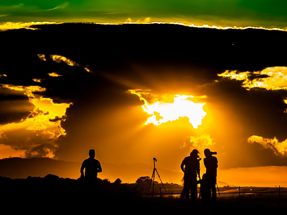 Sunset and people silhouette