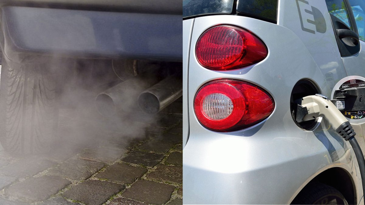 Exhaust from a combustion engine car next to an electric vehicle charging.