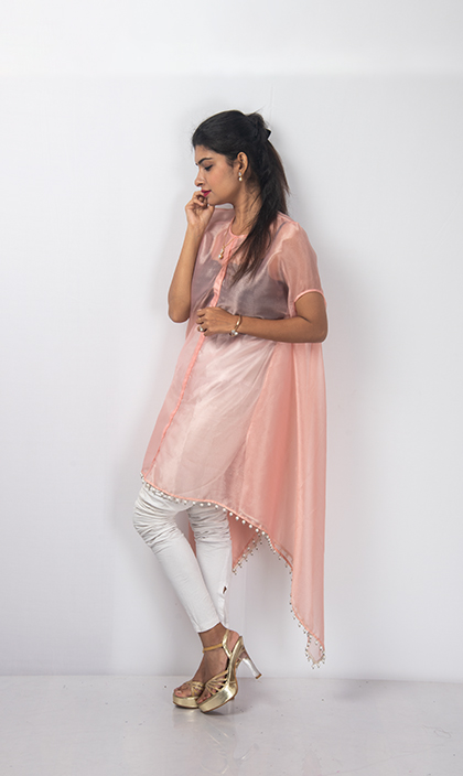 The Organza Kaftan is designed with elongated sleeves. It can be worn as a dress and as a proper Kaftan. It is finished with Pearls on the hemline