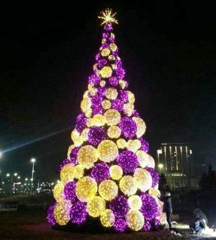 big gold and purple pre lit christmas tree