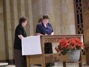 Sister Peggy signs her profession formula.