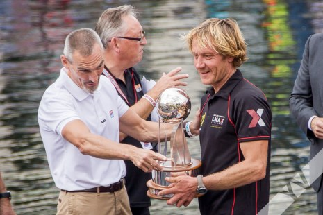 A dry sailor receiving the trophy...