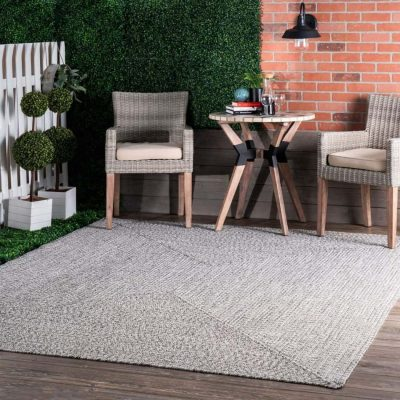 an outdoor rug from blowing away
