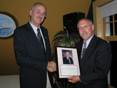 Oct 2004: YHF board member Mark Muise presented an Exemplary Service award to J. Gordon Wood for his unwavering commitment to the development and restructuring of the Yarmouth Hospital Foundation from 1993 onward.