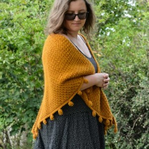 One way of wearing a Tunisian crochet shawl - around the shoulders