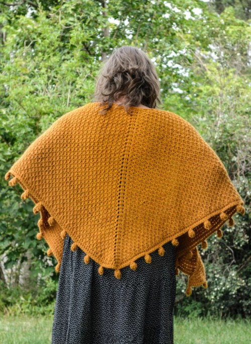 One way of wearing a Tunisian crochet shawl - around the shoulders seen from the back