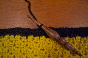 Continue along the edge, crocheting in both squares.