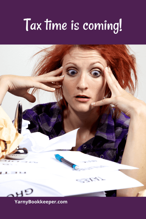 woman looking at a huge pile of bookkeeping paperwork feeling tax time panic