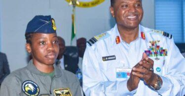 Flying Officer Tolulope Arotile with Air Marshal Sadique Abubakar