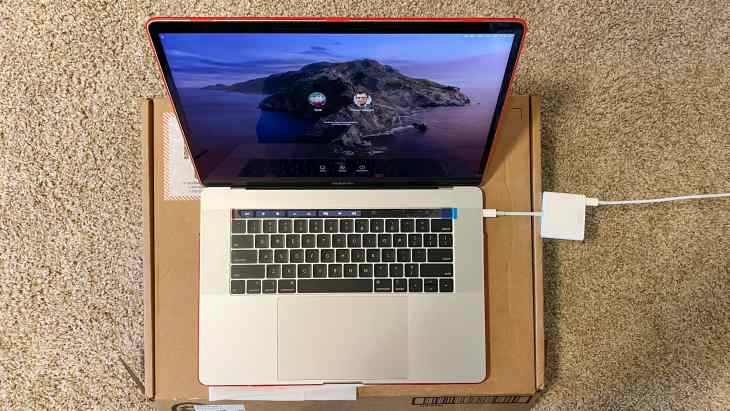 Image of repaired MacBook Pro fully running, sent via UPS with utmost care.