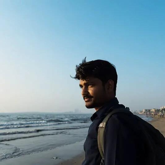 man at beach blue sky dramtic light
