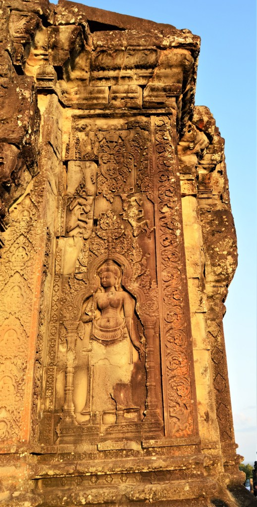 Apsara carved on the facade of the central gopura located atop Phnom Bakheng, Cambodia