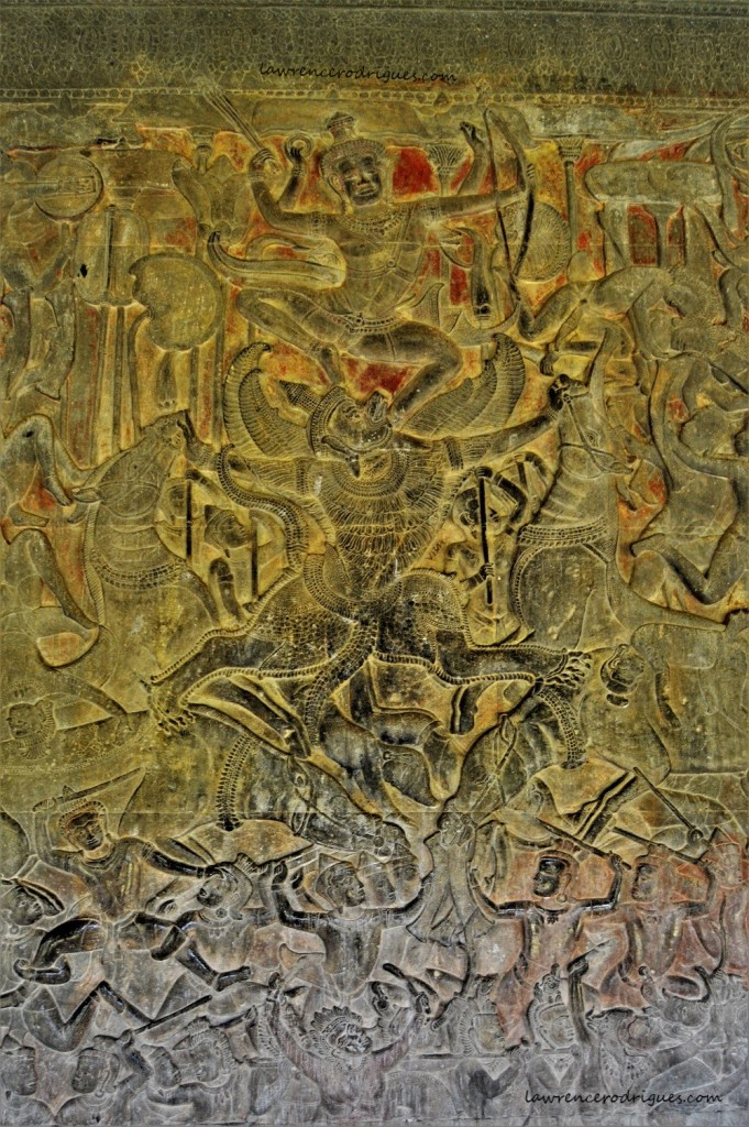 Vishnu riding Garuda depicted in the Gods Vs. Asuras bas-relief carved in the lower-level gallery of the Angkor Wat Temple in Siem Reap, Cambodia