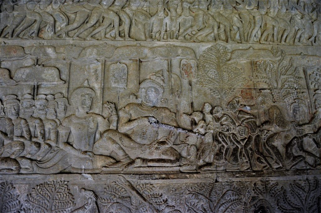 A section of the Heavens and Hells bas-relief depicting Chitragupta, the assessor, checking the records of souls
