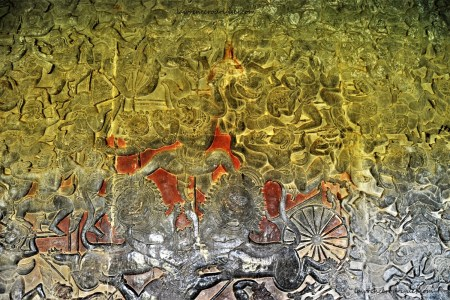 A combat scene in the Battle of Lanka relief depicting a monkey warrior straddled on the heads of two lions carved in the lower-level gallery of the Angkor Wat Temple in Siem Reap, Cambodia